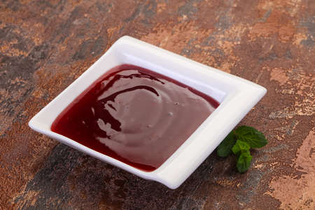 Delicous cowberry sauce with mint leaves