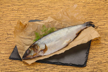 Salted herring over the wooden board with dill 写真素材 - 124989966
