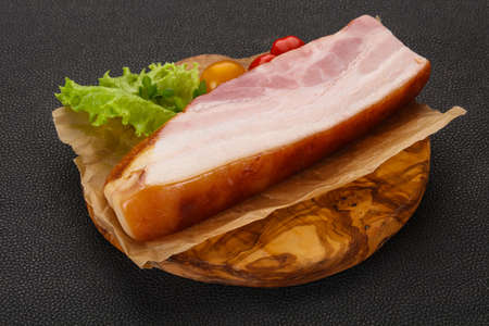 Smoked pork breast with salad leaves and tomatoes Stock Photo