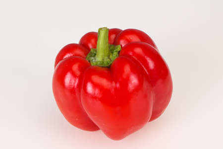 Ripe red bell pepper isolated on white background