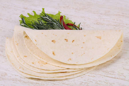 Empty homamade tortilla served salad leaves Banco de Imagens
