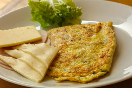 Omelet with cheese and salad leaves