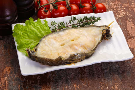 Baked wolffish steak with salad leaves Stock Photo