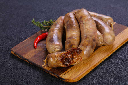 Raw chicken sausages ready for grill Stock Photo