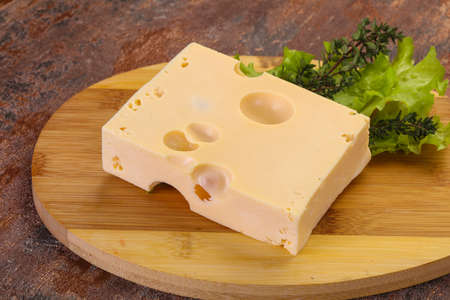 Maasdam cheese brick with thyme branch Imagens