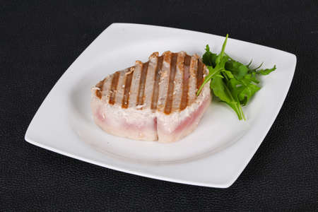Grilled tuna steak served rocket salad