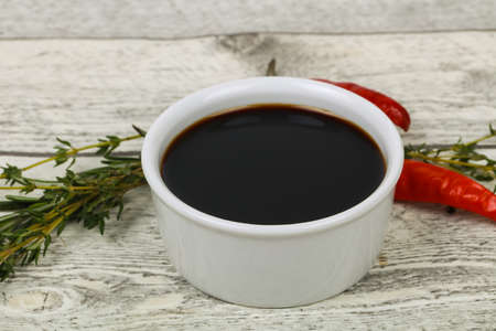 Soya sauce in the bowl served pepper