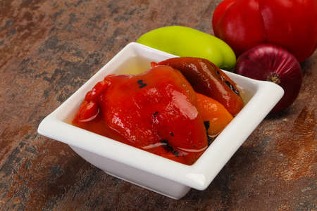 Marinated baked red bell pepper in the bowl