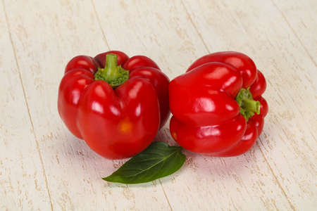 Ripe Red bell pepper over wooden background
