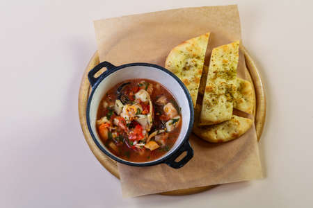 Seafood suop with bread and spices Stock Photo