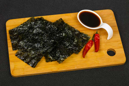 Tasty Nori chips with soya sauce Stock Photo