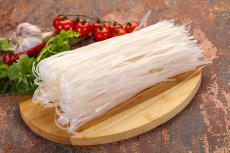 Raw rice noodles served cilantro leaves
