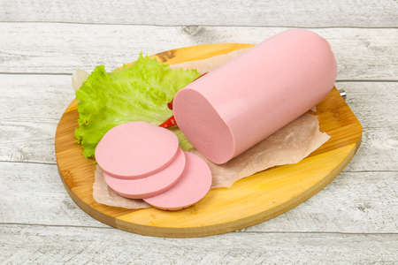 Sliced pork sausage with salad leaves Stock Photo