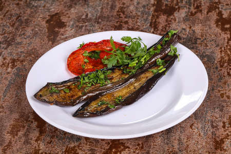 Grilled eggplant with bell pepper served green herbs and spices