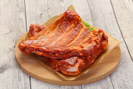 Raw marinated pork ribs ready for cooking Stock Photo
