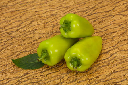 Ripe Green bell pepper over wooden background