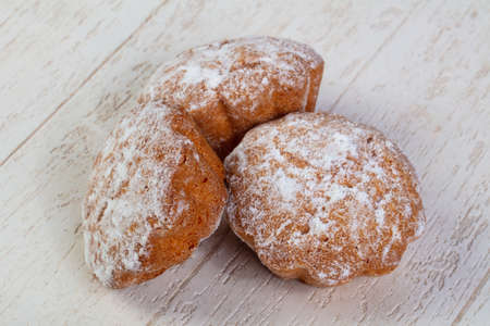 Delicious and sweet baked muffins coated with powdered sugar