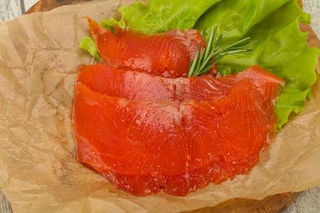 Sliced salmon fillet snack served rosemary Archivio Fotografico