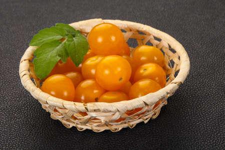Ripe tasty yellow cherry tomato in the bowl
