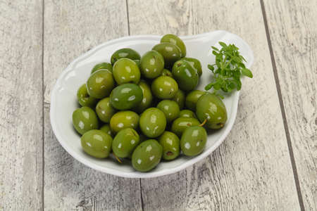 Marinated Green Campo Real olives in the bowl Banco de Imagens