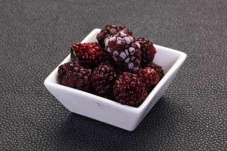 Frozen BlackBerry heap in the bowl 스톡 콘텐츠
