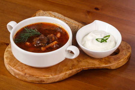 Traditional Russian borsch with beef and sour cream Stock Photo