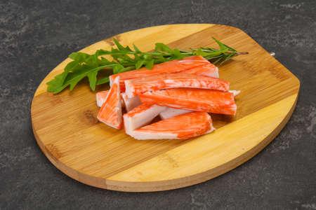Crab stick surimi over wooden board