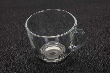 Empty glass cup over black background 免版税图像