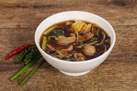 Thai style soup with meat, vegetables and mushrooms 写真素材