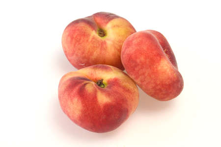 Sweet ripe tasty few flat peaches 스톡 콘텐츠