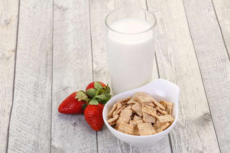 Wheat flakes for breakfast with milk and strawberry Banco de Imagens