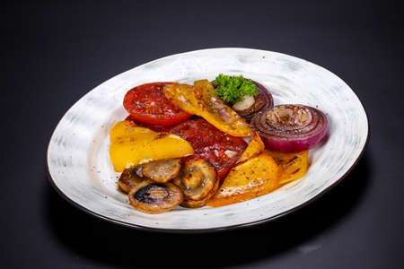 Grilled vegetables - tomato, pepper, mushroom and violet onion