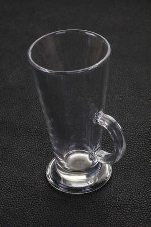 Empty glass cup over black background Stock fotó