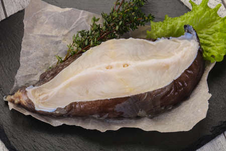 Raw wolffish steak ready for cooking 写真素材