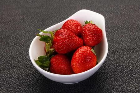 Ripe fresh Strawberry heap in the bowl