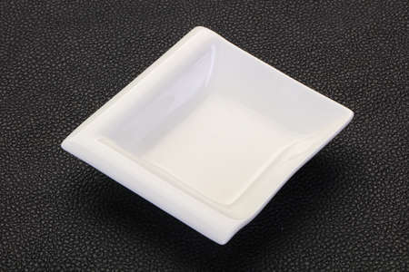 White porcelain bowl over black background