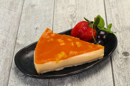Cheesecake with apricot served strawberry and mint Banco de Imagens - 128602135