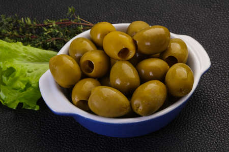 Big green olives in the bowl