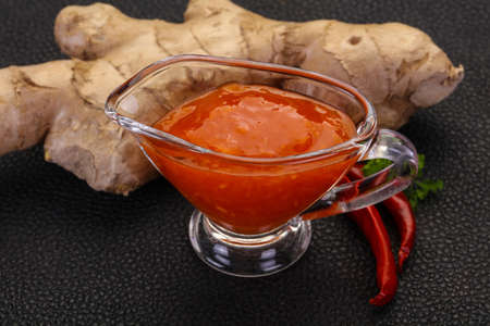 Ginger chili sauce with root and pepper Imagens