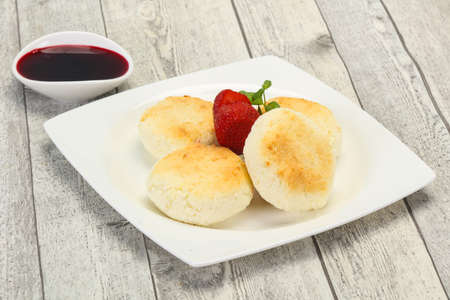 Curd pancakes with jam and strawberry served mint