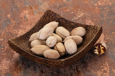 Pecan nuts heap in the bowl