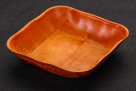 Empty bamboo bowl over black background Imagens