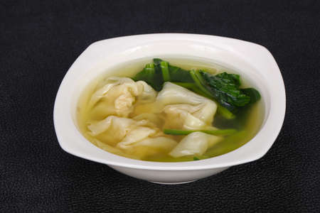 Asian traditional Wanton soup with herbs and spices Banco de Imagens - 128602480