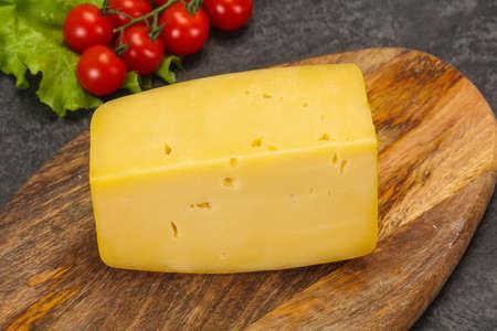 Swiss Hard yellow tasty cheese brick Banco de Imagens - 128602324