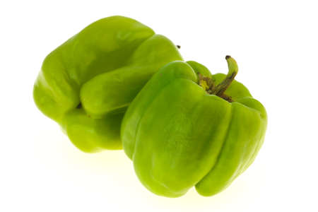 Two Green bell pepper isolated on white background Banco de Imagens