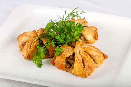 Pastry with meat served parsley Stock Photo