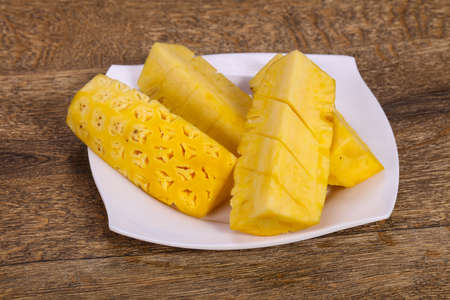 Sliced sweet ripe tasty pineapple in the plate
