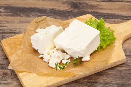 Greek traditional Feta soft cheese in the plate Imagens