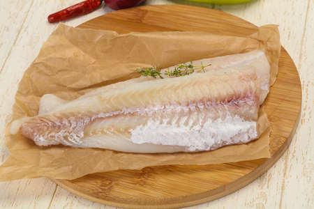 Pollack fillet raw ready for cooking over wooden