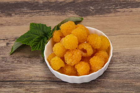 Sweet ripe tasty yellow raspberry with leaf